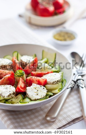 Salad with cucumber, tomatoes and goat cheese