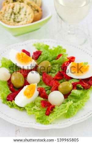 salad with egg, pepper and olives