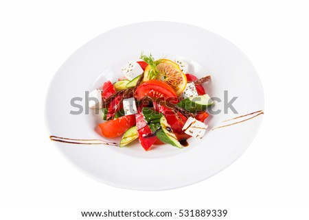 salad with feta cheese,lemon and vegetables  isolated on white