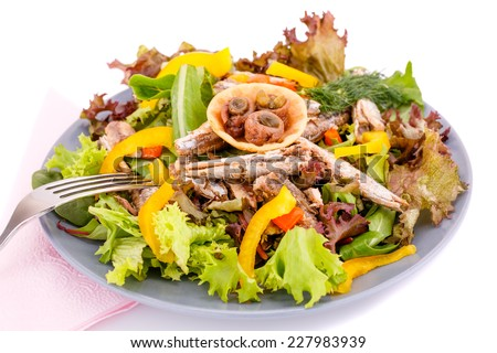 Salad with fish and fresh vegetables on white background. - stock photo