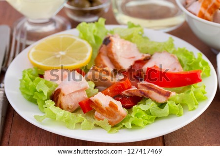 salad with fish on the white plate
