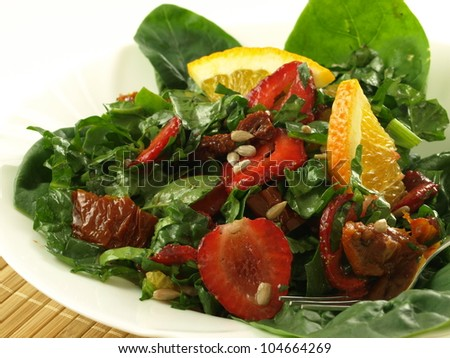 Salad with fresh and dried fruits and vegetables - stock photo