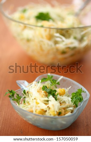 salad with fresh cabbage in a bowl on the table