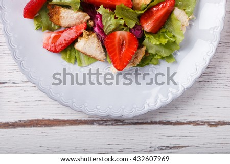 Salad with fresh strawberries,herbs and chicken meat,tossed with  vinaigrette. Healthy food or diet concept.selective focus. - stock photo