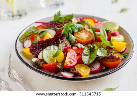 Salad with fresh summer vegetables, selective focus - stock photo