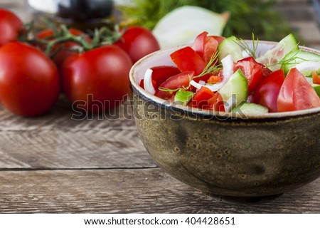 salad with fresh tomatoes, cucumbers, peppers and onions - stock photo