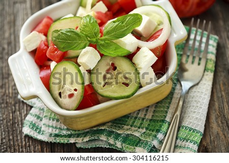 salad with fresh vegetables and cheese - stock photo