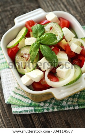 salad with fresh vegetables and feta cheese - stock photo