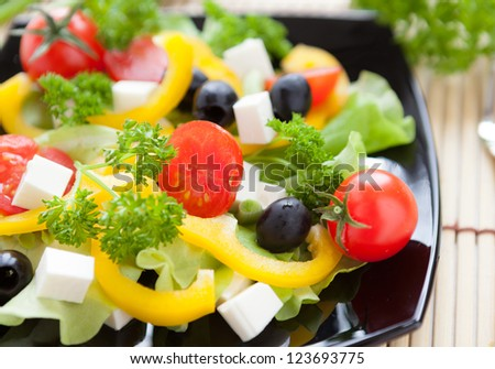 salad with fresh vegetables and feta cheese, closeup