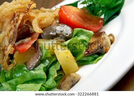 Salad with fried onions, potatoes and mushrooms