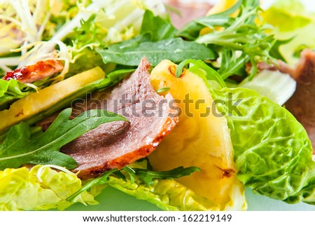 salad with greens, pineapple and smoked meat