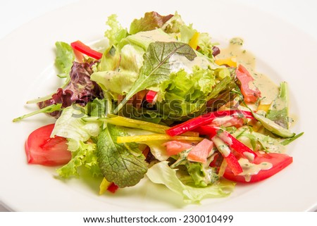 salad with greens vegetables. vegetarian cuisine.. On white background