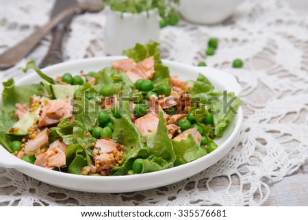 Salad with grilled salmon - stock photo