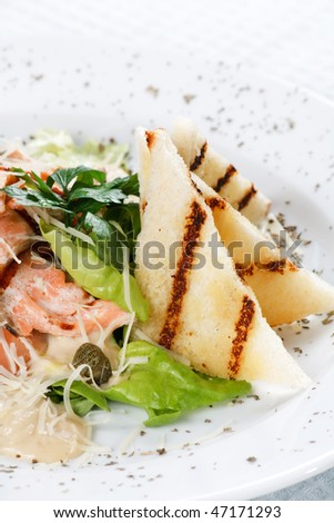 salad with grilled salmon fillet - stock photo