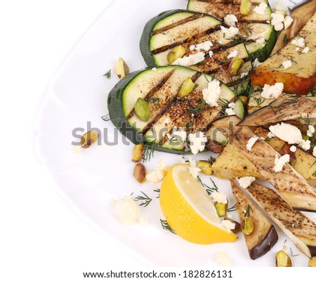 Salad with grilled vegetables and tofu. Whole background.