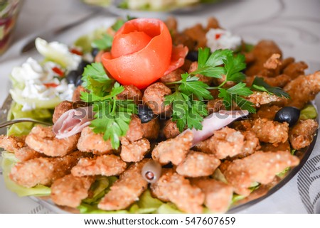 salad with meatballs and chicken meat on the table