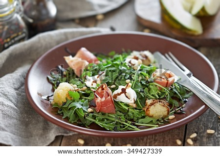 Salad with Melon and Prosciutto - stock photo