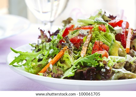 Salad with mixed lettuce, carrot, avocado, tomato and capsicum.  Delicious, healthy eating.