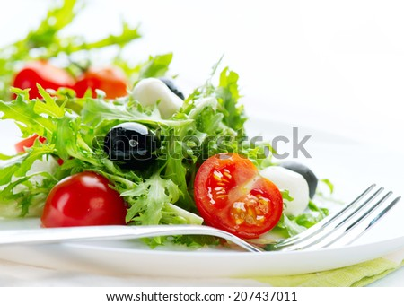 Salad with Mozzarella Cheese isolated on white background. Vegetarian food. Diet& Dieting concept - stock photo