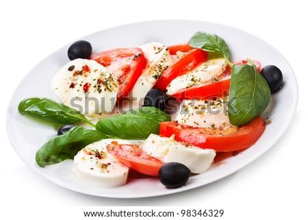 salad with mozzarella, tomatoes and basil on white background - stock photo