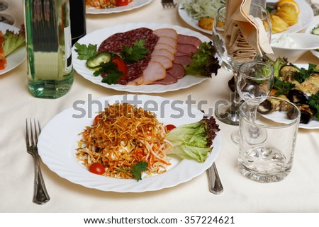Salad with mushrooms, french fries and cherry tomatoes on a festive table. Selective focus. - stock photo