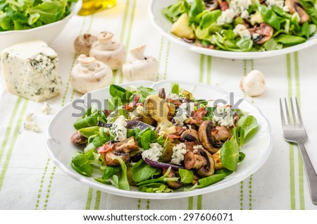 Salad with new potatoes and blue cheese, bacon, olive oil and great dressing from dijon mustard - stock photo