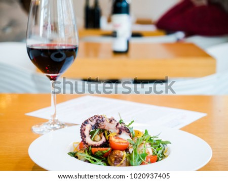 salad with octopus, potatoes and wine