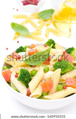 salad with pasta, smoked salmon, broccoli, green peas and ingredients in the background, isolated on a white background