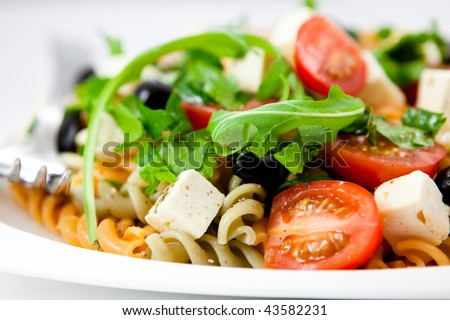 Salad with pasta,vegetables and feta - stock photo