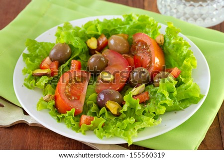 salad with pistachios on white plate