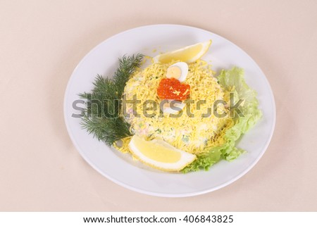 salad with quail egg and red caviar served with lemon 