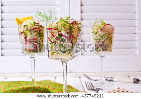 Salad with quinoa and vegetables on a wooden background. Selective focus. - stock photo