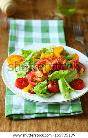 salad with red and yellow peppers and lettuce, food - stock photo