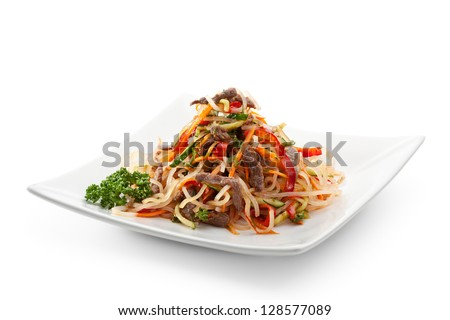 Salad with Rice Noodles, Fried Veal and Vegetables - stock photo