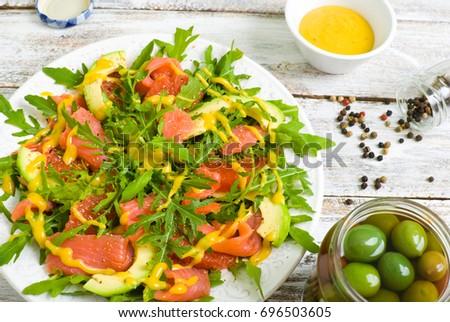 Salad With Rocket Salad Arugula Avocado Grapefruit Red Fish And Mustard Sauce On