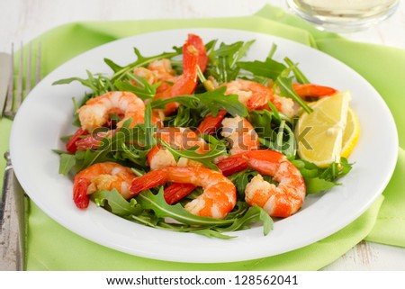 salad with seafood on the white plate