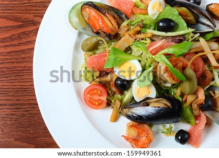 Salad with seafood with a squid, a tuna fillet, meat of mussels - stock photo