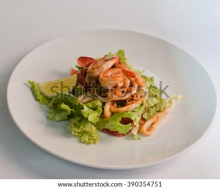 Salad with shrimp and squid - stock photo