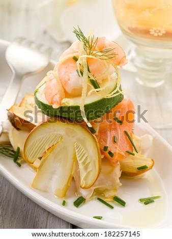 salad with shrimp salmon carpaccio and slice ovum mushroom  - stock photo