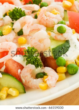 Salad with shrimps, fresh vegetables and cream sauce. Shallow dof.