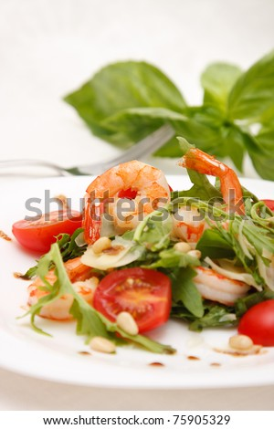 Salad with shrimps, rucola,tomato and parmezan - stock photo