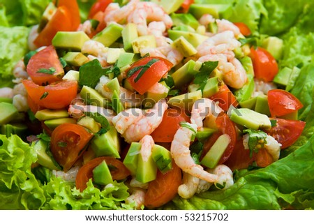 Salad with shrimps, tomato and avocado.
