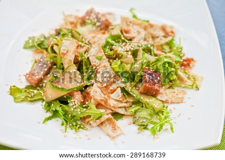Salad with smoked eel. Japanese food - stock photo