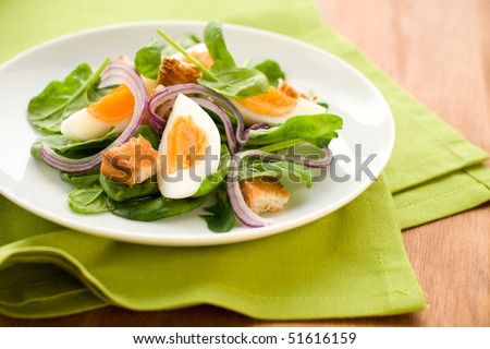 salad with spinach,eggs and croutons - stock photo