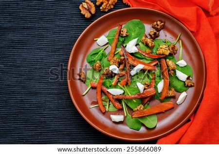 salad with spinach, mozzarella, walnuts and caramelized carrots. tinting. selective focus - stock photo