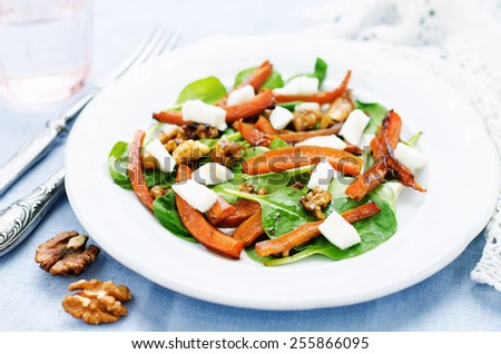 salad with spinach, mozzarella, walnuts and caramelized carrots. tinting. selective focus