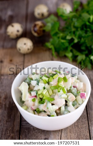 Salad with squids and quail eggs