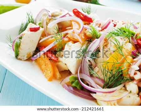 Salad with steamed mackerel icefish fillet, veggies and herbs. Shallow dof. - stock photo