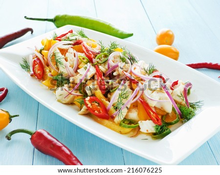 Salad with steamed mackerel icefish fillet veggies and herbs. Shallow dof.