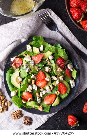 salad with strawberry, spinach leaves and blue cheese - stock photo